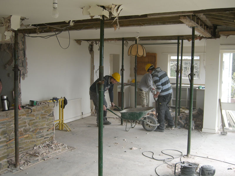 Demolition in progress, walls removed and roof supports in place by Dyfi Renovations Ltd