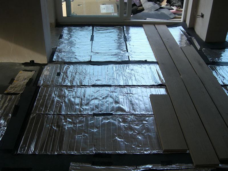 Heated floor being installed from Dyfi Renovations Ltd
