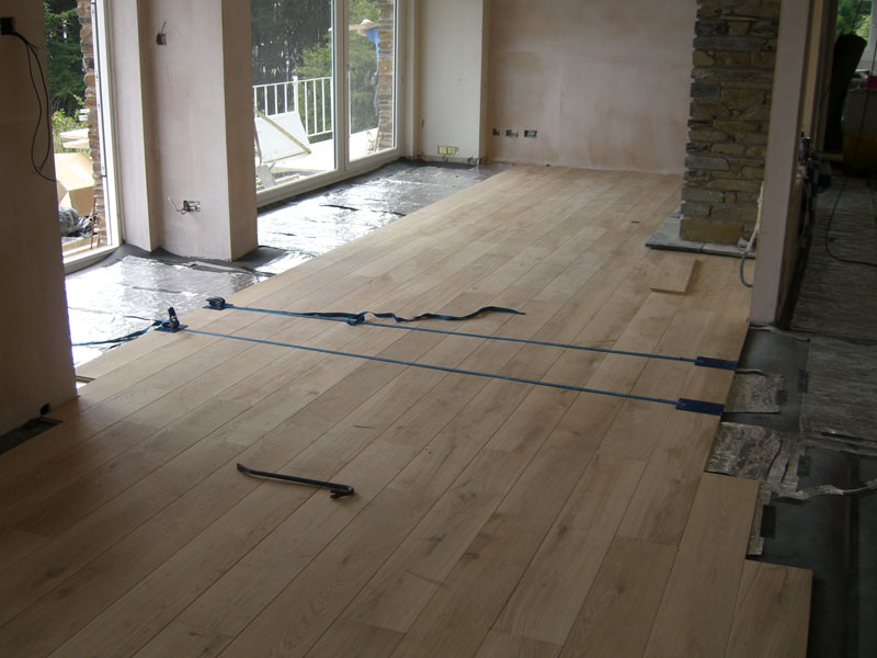 Oak flooring being installed by Dyfi Renovations Ltd