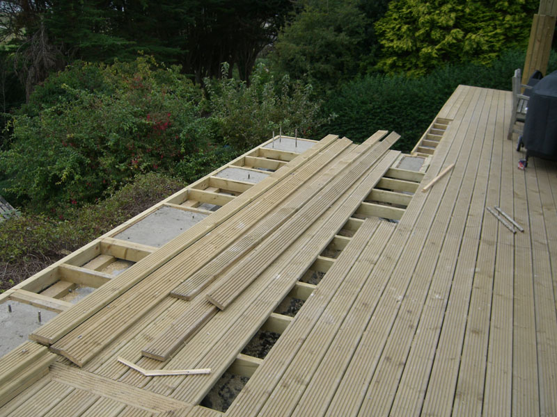 Decking being laid by Dyfi Renovations Ltd