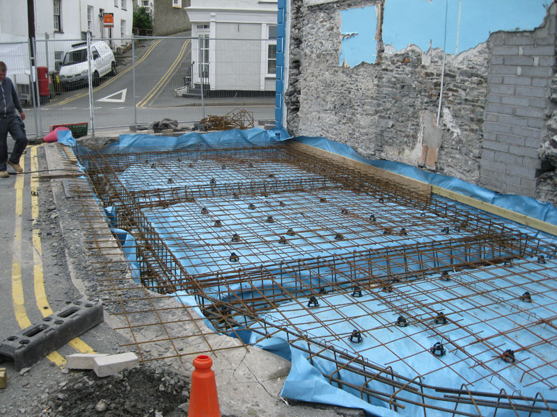 Preparing foundations for new building by Dyfi Renovations Ltd