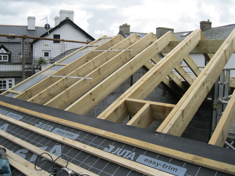 Installing new roof timbers and covers by Dyfi Renovations Ltd
