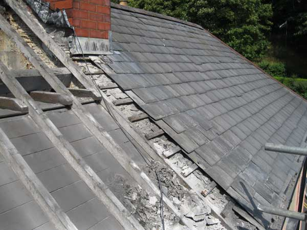 Work on replacing roof on terrace house by Dyfi Renovations Ltd