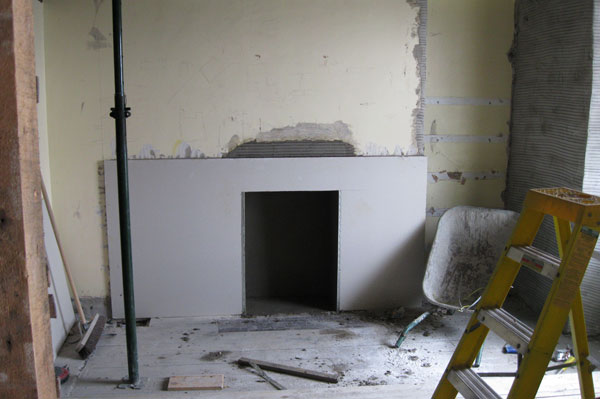 Forming new fireplace by Dyfi Renovations Ltd